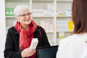 older adult talking with pharmacist