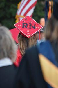 RN on back of graduation hat